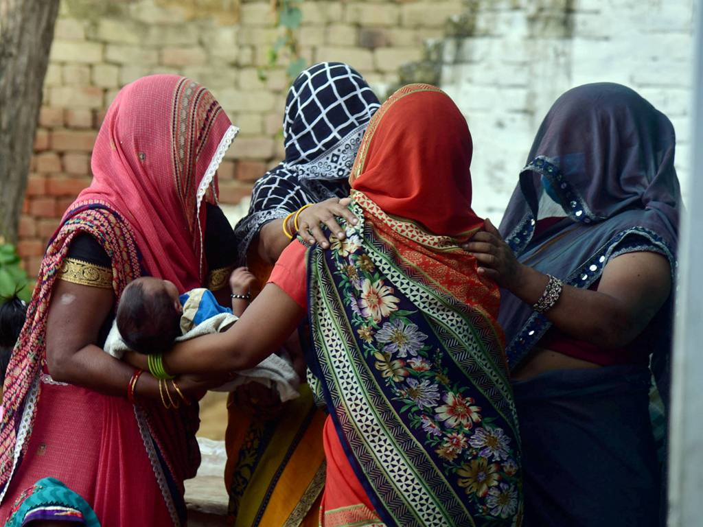 Hathras: Family members and relatives mourn the death of a 19-year-old woman, who was gang-raped two weeks ago, in Hathras district, Tuesday, Sept. 29, 2020. The Dalit teen died at a hospital in Delhi on Tuesday morning. (PTI Photo)(PTI29-09-2020 000173B